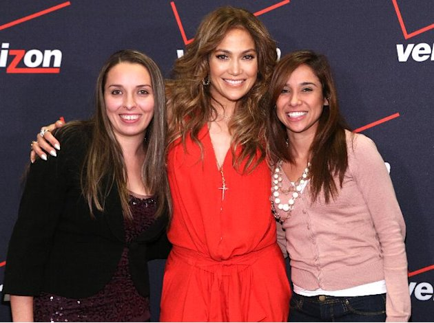 Jennifer Lopez poses for a picture with Flyaway Winners at the Verizon Wireless meet Jennifer Lopez Flyaway Contest, on Saturday, Jan. 26, 2013 in Santa Monica, Calif. (Photo by Casey Rodgers/Invision