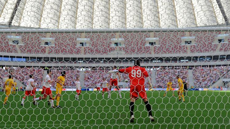 Polish and Ukrainian celebrities play a friendly soccer match at the National Stadium in Warsaw, Poland, Sunday, April 29, 2012. The game was the last event at the site before the opening of the Euro 2012 soccer championships, which will open in this stadium. (AP Photo/Alik Keplicz)