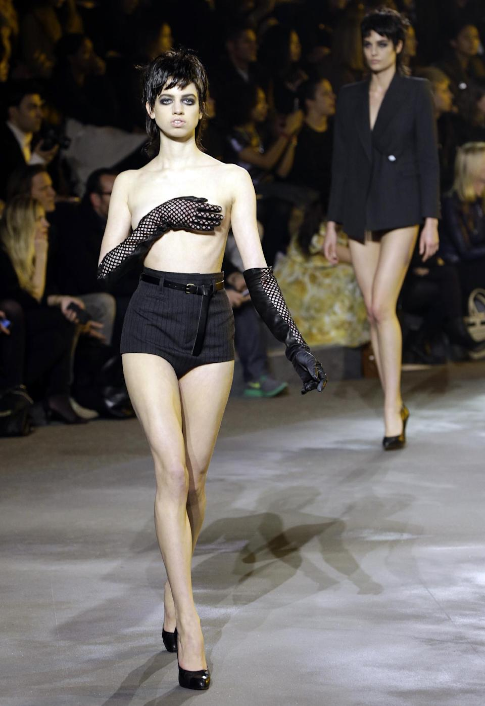 A topless model walks the runway during the Marc Jacobs Fall 2013 fashion show Fashion Week in New York, Thursday, Feb. 14, 2013.  (AP Photo/Kathy Willens)