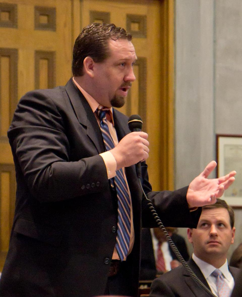 Rep. Jeremy Faison, R-Cosby, speaks in favor of a proposed constitutional amendment to ban a state income tax on the House floor in Nashville, Tenn., on Thursday, Jan. 19, 2012, while Rep. Barrett Rich, R-Somerville, looks on. (AP Photo/Erik Schelzig)