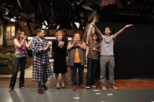 """Ashton Kutcher waves during the curtain call after filming the  season premiere episode of """"Two and a Half Men,"""" alongside  Marin Hinkle, Jon Cryer, Holland Taylor, Conchata Ferrell and Angus T. Jones -- CBS"""