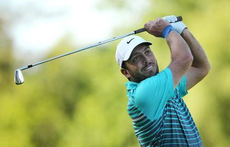 Molinari hits the front at Wentworth while McIlroy toils