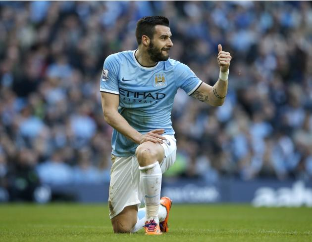 Manchester City's Negredo gestures during their English FA Cup quarter final soccer match against Wigan Athletic at the Etihad stadium in Manchester
