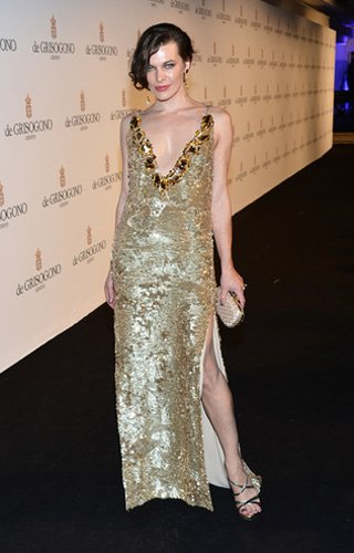 Who: Milla Jovovich What: Gold Prada gown Where: De Grisgono party Why We Love It: Surprise! It's another entry into the Best Thigh-High Slits of Cannes category. Jovovich glows in this plunging Prada