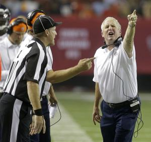 FILE - This Sept. 17, 2012 file photo shows Denver Broncos head coach John Fox gesturing while speaking to officials during the first half of an NFL football game against the Atlanta Falcons, in Atlanta. The numbers say there isn't much difference between NFL games worked by the regular officials and the ones being worked this season by their replacements. Comments from players and coaches say otherwise. (AP Photo/John Bazemore, FIle)