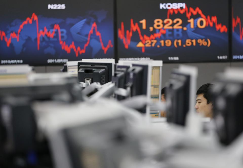 A currency trader watches his monitors at the foreign exchange dealing room of the Korea Exchange Bank headquarters in Seoul, South Korea, Thursday, July 19, 2012. South Korea's Kospi rose 1.56 percent, or 28.05 points, to close at 1,822.96.(AP Photo/ Lee Jin-man)