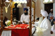 Sikh priests pray for their neighbors killed in an attack on a Wisconsin Sikh temple on August 6, 2012 in Brookfield, Wisconsin. Sikhs in America have long been incorrectly linked to Middle East turmoil, despite the fact that the religion originated in South Asia&#39;s Punjab region