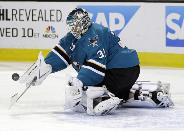 San Jose Sharks goalie Antti Niemi, of Finland, stops a shot during the second period of an NHL hockey game against the Toronto Maple Leafs on Tuesday, March 11, 2014, in San Jose, Calif
