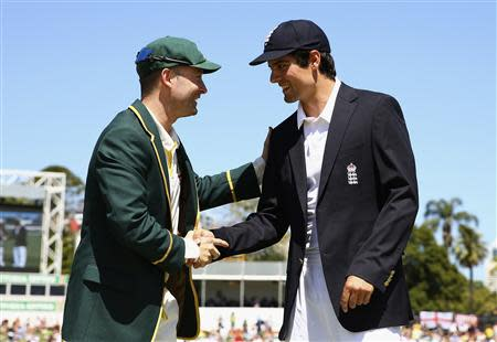 Australia's captain Clarke shakes hands with England's captain Cook after the toss of coin before the start of the first day of the third Ashes cricket test at the WACA ground in Perth