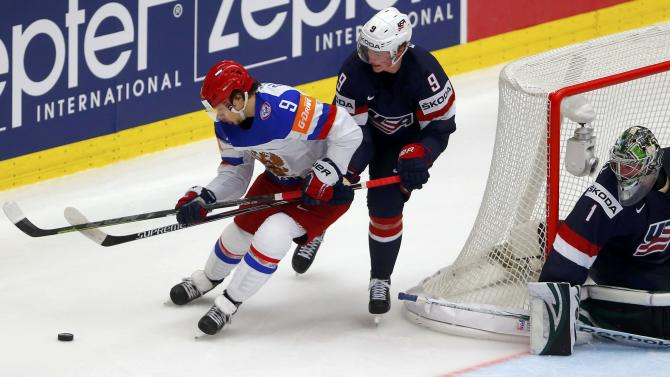 Russia's Panarin fights for the puck with Eichel of the US during their ice hockey World Championship game against Russia during their ice hockey World Championship game in Ostrava