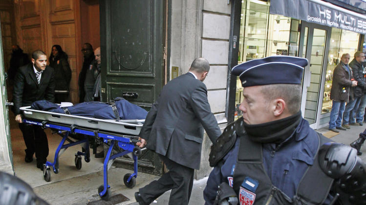 One of the three bodies of the killed Kurdish women is taken out of the building in Paris, Thursday Jan. 10, 2013. Police say three Kurdish women have been shot dead at a pro-Kurdish centre in Paris in what the French interior minister is calling an 'execution'. (AP Photo/Remy de la Mauviniere)