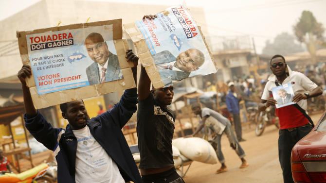 Supporters of Presidential candidate Faustin Archange Touadera rally during a sand storm in the streets of Bangui, Central African Republic,  Friday Feb. 12, 2016. Two former prime ministers, Touadera and Anicet Georges Dologuele, are running neck-and-neck in the second round of presidential elections Sunday Feb. 14  to end years of violence pitting Muslims against Christians in the Central African Republic. (AP Photo/Jerome Delay)