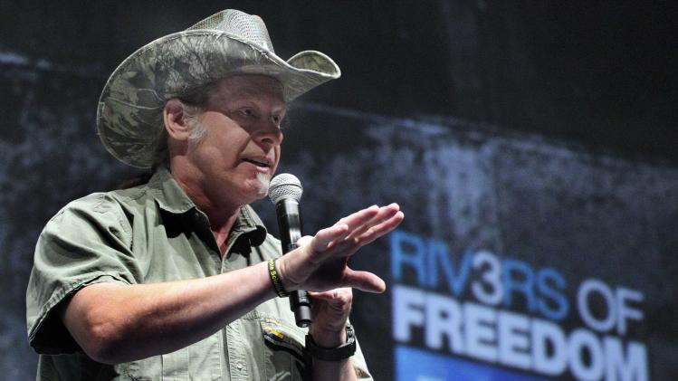 "FILE - In this May 1, 2011, file photo, musician and gun rights advocate Ted Nugent addresses a seminar at the National Rifle Association's 140th convention in Pittsburgh. Nugent said he was insulted by the cancellation of his planned concert at an Army post over his comments about President Barack Obama. Commanders at the Fort Knox, Ky., post nixed Nugent's segment of a June concert after the rocker and conservative activist said at a recent National Rifle Association meeting that he would be ""dead or in jail by this time next year"" if Obama is re-elected. (AP Photo/Gene J. Puskar, File)"