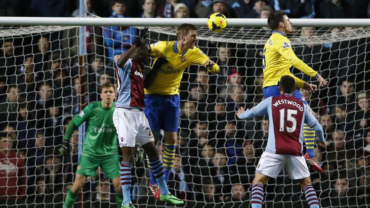 Arsenal beats Villa 2-1, back atop Premier League