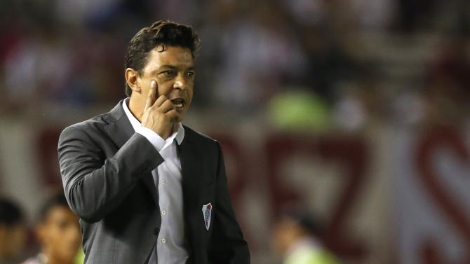 Gallardo, coach of Argentina's River Plate, addresses his players playing their Copa Libertadores soccer match against Mexico's Tigre in Buenos Aires