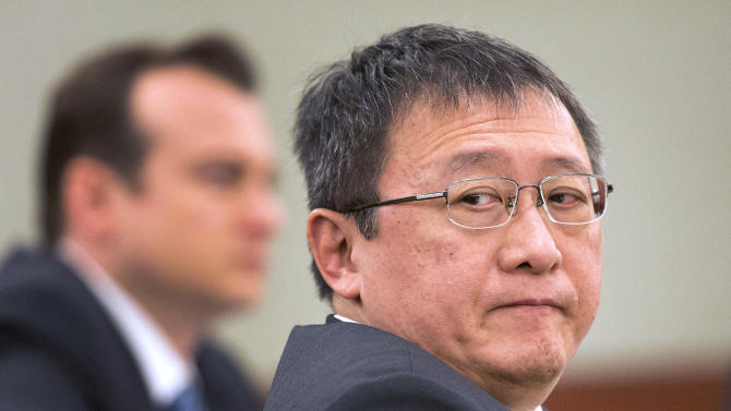 FILE - In this April 4, 2013 file photo, Hong Kong businessman Richard Suen waits as counsel addresses the judge during a trial against the Las Vegas Sands Corp. in Clark County district court in Las Vegas. A jury on Tuesday, May 14, 2013 awarded Suen a $70 million judgment against Las Vegas Sands Corp., the casino giant run by billionaire Sheldon Adelson. Suen claimed he was owed up to $328 million for helping the Las Vegas-based company secure a lucrative gambling license in Macau, the only place in China where casino gambling is legal. (AP Photo/Julie Jacobson, File)
