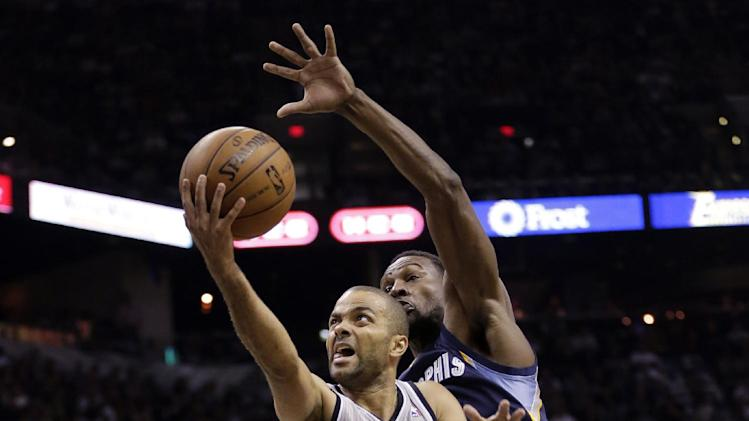 San Antonio Spurs' Tony Parker (9), of France, shoots as Memphis Grizzlies' Tony Allen, right, reached over to defend him during the first half in Game 1 of a Western Conference Finals NBA basketball playoff series, Sunday, May 19, 2013, in San Antonio. (AP Photo/Eric Gay)