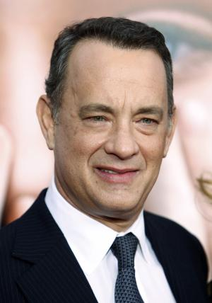 """FILE - In this Dec. 15, 2011 file photo, actor Tom Hanks attends the premiere of """"Extremely Loud & Incredibly Close"""" at the Ziegfeld Theatre in New York. """"Electric City,"""" an animated futuristic series Hanks has been developing for years, will premiere on Yahoo this spring. The series includes 20 episodes, each three- or four-minutes long. (AP Photo/Peter Kramer, File)"""