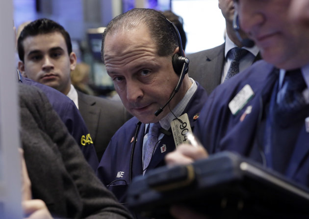 <p>               In this Friday, Jan. 25, 2013, photo, Trader Michael Urkonis, center, works on the floor of the New York Stock Exchange. Wall Street appeared headed for a day of trade without drama Monday Jan. 28, 2013.  (AP Photo/Richard Drew)