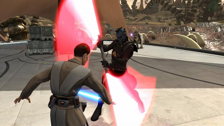 "In this video game image released by Microsoft, a player wields a virtual light saber against Darth Maul in ""Kinect Star Wars.""  (AP Photo/Microsoft)"