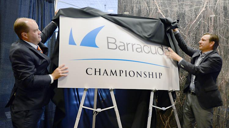 Chriss Hoff, tournament director for the Reno Tahoe Open, left, and Michael Hughes with Barracuda unveil the new name and logo for the tournament at City Hall on Wednesday July 9, 2014 in Reno, Nev.. The Reno-Tahoe Open has landed a new title sponsor and is changing its name to the Barracuda Championship under a four-year, multimillion-dollar deal with California-based Barracuda Networks Inc., tournament and PGA Tour officials announced Wednesday. (AP Photo/The Reno Gazette-Journal, Marilyn Newton) NO SALES; NEVADA APPEAL OUT; SOUTH RENO WEEKLY OUT