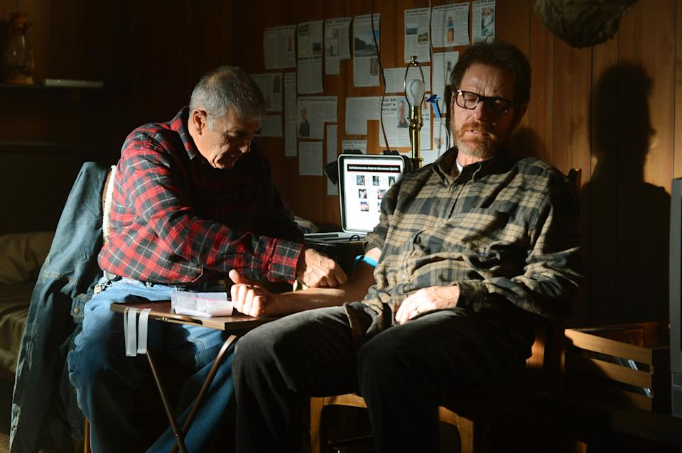"This image released by AMC shows Ed, a fixer portrayed by Robert Forster, administering medicine to Walter White, played by Bryan Cranston in a scene from the final season of ""Breaking Bad."" The series finale of the popular drama series airs on Sunday, Sept. 29. (AP Photo/AMC, Ursula Coyote)"