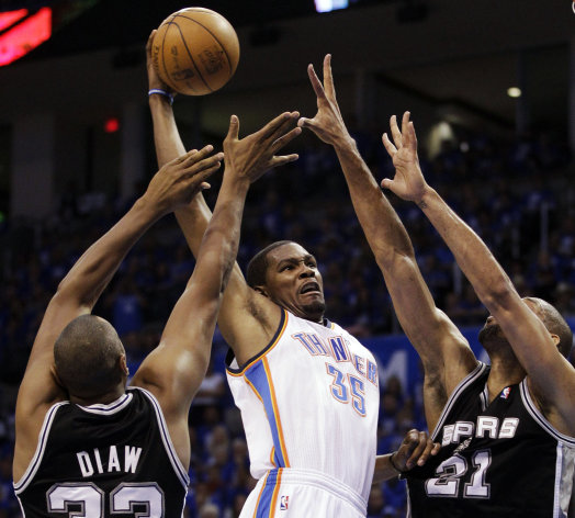 Oklahoma City Thunder small forward Kevin Durant (35) shoots against San Antonio Spurs&#39; Boris Diaw (33), of France ,and Tim Duncan (21) during the first half of Game 3 in their NBA basketball Western Conference finals playoff series, Thursday, May 31, 2012, in Oklahoma City. (AP Photo/Sue Ogrocki)