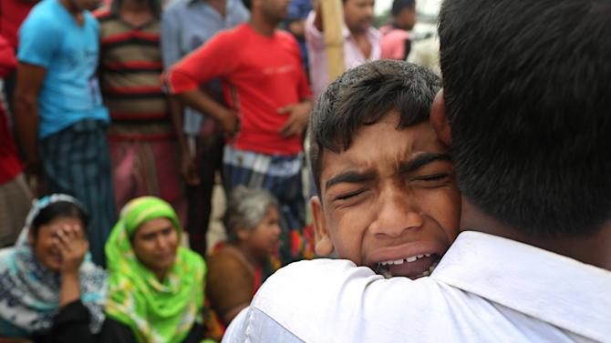 A Bangladeshi boy cries for his mother, missing after a ferry they were travelling in capsized in the River Padma in Munshiganj district, Bangladesh, Tuesday, Aug. 5, 2014. Rescuers were struggling Tuesday to locate a sunken ferry that was overloaded and carrying hundreds of passengers when it capsized in the river in central Bangladesh, leaving at least two people dead and probably many more. (AP Photo/A.M. Ahad)