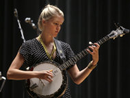 In this photo taken Thursday, Sept. 6, 2012, Ashley Campbell, daughter of singer Glen Campbell, plays her banjo the afternoon before a performance in her father's Goodbye Tour in Little Rock, Ark. (AP Photo/Danny Johnston)