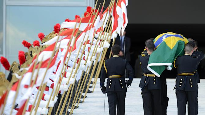 The coffin containing the remains of Brazilian architect Oscar Niemeyer is carried past an honor guard up a ramp leading to the Planalto presidential palace, in Brasilia, Brazil, Thursday, Dec. 6, 2012. Niemeyer, 104, the groundbreaking architect who designed Brazil's futuristic capital and much of the United Nations complex, died Wednesday night in Rio de Janeiro, the seaside city where he was born and where his remains will be buried after he is honored with a service in Brasilia at the presidential palace he designed. (Photo/Cadu Gomes)