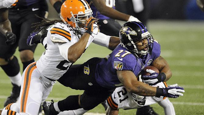 Baltimore Ravens running back Ray Rice (27) is stopped by Cleveland Browns free safety Usama Young (28) and cornerback Dimitri Patterson (21) during the first half of an NFL football game in Baltimore, Thursday, Sept. 27, 2012. (AP Photo/Nick Wass)