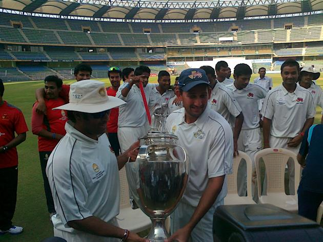 Sachin Tendulkar and Mumbai skipper Ajit Agarkar hold aloft the Ranji Trophy for 2012-13. Mumbai won the title after defeating Saurashtra by an innings and 125 runs on January 28th 2013. Picture by Sk