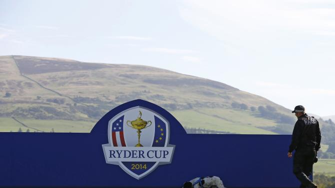 A police sniffer dog checks a hoarding during practice ahead of the 2014 Ryder Cup at Gleneagles in Scotland