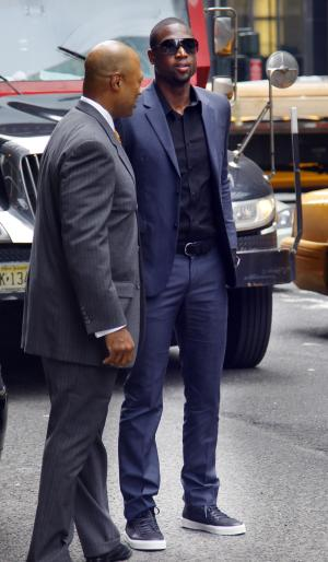 Miami Heat's Dwyane Wade, right, arrives for a meeting with the NBA owners' labor relations committee and the players' union executive committee on Friday, Sept. 30, 2011 in New York. AP Photo/Bebeto Matthews)