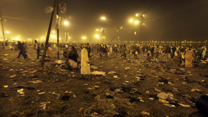 Shoes and other belonging discarded by Hindu devotees are seen strewn across the ground at 'Sangam', the confluence of Hindu holy rivers Ganges, Yamuna and the mythical Saraswati, during the Maha Kumbh festival at Allahabad, India, Sunday, Feb. 10, 2013.  Led by heads of monasteries arriving on chariots and ash-smeared naked ascetics, millions of devout Hindus plunged into the frigid waters of the holy Ganges River in India on Sunday in a ritual that they believe will wash away their sins. Sunday was the third of six auspicious bathing days during the Kumbh Mela, or Pitcher Festival, which lasts 55 days and is one of the world's largest religious gatherings. (AP Photo /Rajesh Kumar Singh)