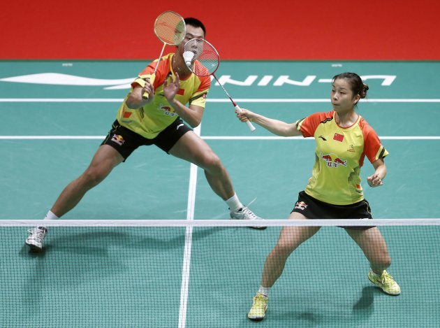 China's Ma with partner Xu plays a shot during their mixed doubles badminton match against Indonesia's Tontowi and Lilyana at the quarterfinals of the Sudirman Cup World Team Badminton Championships i