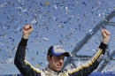 Brad Keselowski celebrates after winning a NASCAR Sprint Cup Series auto race on Sunday, March 9, 2014, in Las Vegas. Keselowski overtook Dale Earnhardt Jr. on the last lap when Earnhardt ran out of fuel. (AP Photo/Julie Jacobson)