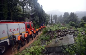 Rescue workers head to the site of a massive landslide …