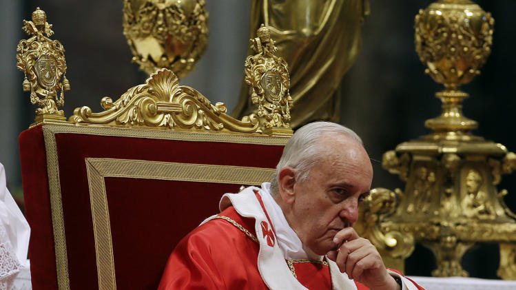 Pope Francis pauses after he bestowed the Pallium to 35 Archbishops, during a mass in St. Peter's Basilica, at the Vatican, Saturday, June 29, 2013. The Pallium is a woolen shawl symbolizing the archbishops' bond to the pope. (AP Photo/Gregorio Borgia)