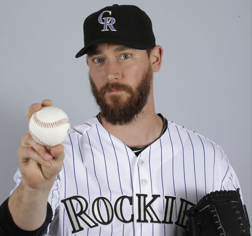 Rockies pitcher Axford's son improves following snake bite