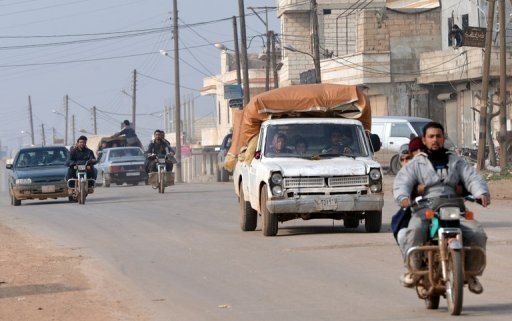 "<p>Syrian residents drive motorcycles and cars to flee during fighting between rebels and regime forces in the village of Kurnaz, close to the western city of Hama, on January 27, 2013. The Syrian opposition appealed Monday for hundreds of millions of dollars (euros) to step up the revolt against Bashar al-Assad, as the president asserted his forces had made ""significant gains"" in the conflict.</p>"