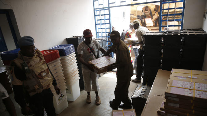 Ballots and other voting materials are unloaded from a UN truck at a polling station in Bangui, Central African Republic, Saturday Feb. 13, 2016. Two former prime ministers, Faustin Archange Touadera and Anicet Georges Dologuele, are running neck-and-neck in the second round of presidential elections Sunday Feb. 14  to end years of violence pitting Muslims against Christians in the Central African Republic. Central Africans will also vote in legislative elections. (AP Photo/Jerome Delay)