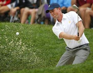 U.S. team member Webb Simpson hits from a bunker on the 14th hole as he plays International player Louis Oosthuizen of South Africa during the Singles matches for the 2013 Presidents Cup golf tournament at Muirfield Village Golf Club in Dublin