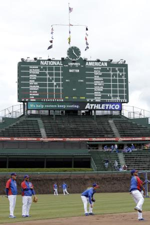 In this photo made April 8, 2013, Chicago Cubs players work out at Wrigley Field, before a baseball game between the Milwaukee Brewers and the Chicago Cubs in Chicago. In an agreement announced Sunday, April 14, 2013, the historic ballpark will get a $500 million facelift, including its first electronic outfield video board, as part of a hard-fought agreement between the City of Chicago and the ball team. (AP Photo/Nam Y. Huh)
