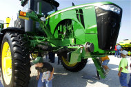 <p>               In this Aug. 31, 2011 photo, young attendees to the Farm Progress Show, in Decatur, Ill., inspect and climb aboard a new John Deere 4940 Self-Propelled Sprayer, in Decatur, Ill.  Deere & Co. said Wednesday, Nov. 23, 2011, strong demand for its farm equipment helped boost the company's fourth quarter profit by 46 percent, and next year should be better because Deere expects demand will remain robust.(AP Photo/Seth Perlman)