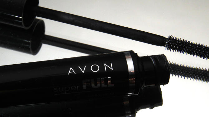 FILE - In this July 28, 2010 file photo, a container and brush of Super Full mascara by Avon sits on display in North Andover, Mass. Direct beauty products seller Avon Products said Thursday, Nov. 1, 2012 its third-quarter net income fell 81 percent, hurt by the stronger dollar and an impairment charge. The company also slashed its dividend. (AP Photo/Elise Amendola, File)