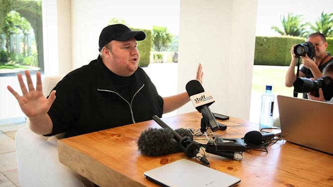 "Indicted Megaupload founder Kim Dotcom holds a press conference ahead of the launch of a new file-sharing website called ""Mega"" at his Coatesville mansion in Auckland, New Zealand, Sunday, Jan. 20, 2013. The colorful entrepreneur unveiled the site ahead of a lavish gala and press conference on the one-year anniversary of his arrest on racketeering charges related to his now-shuttered Megaupload file-sharing site. (AP Photo/New Zealand Herald, Richard Robinson) NEW ZEALAND OUT, AUSTRALIA OUT"