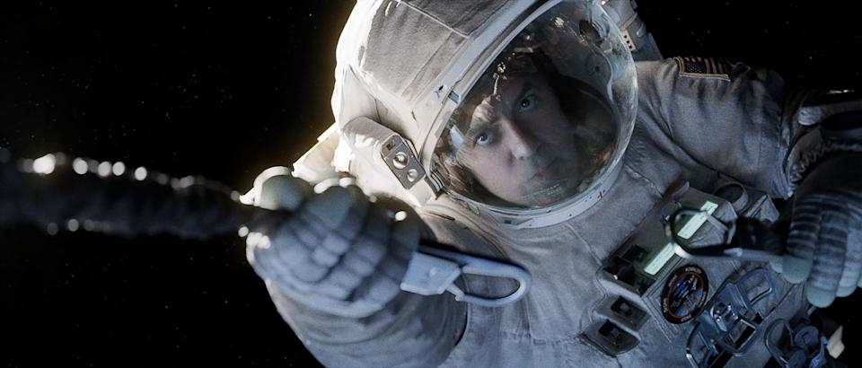 "This film image released by Warner Bros. Pictures shows George Clooney in a scene from ""Gravity."" (AP Photo/Warner Bros. Pictures)"