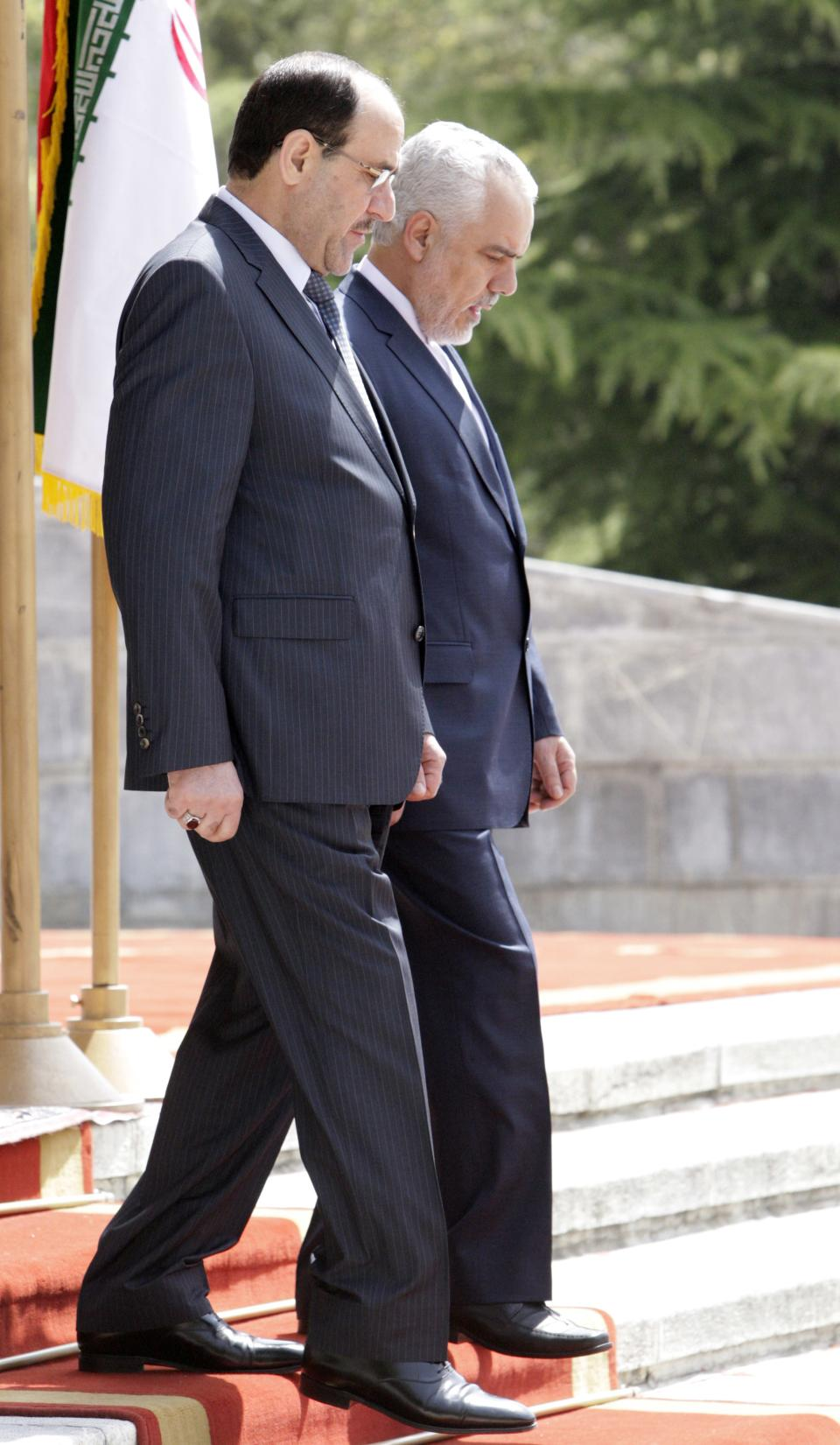 Iraqi Prime Minister Nouri al-Maliki, left, attends an official arrival ceremony as he is accompanied by Iranian Vice-President Mohammad Reza Rahimi in Tehran, Iran, Sunday, April 22, 2012. (AP Photo/Vahid Salemi)
