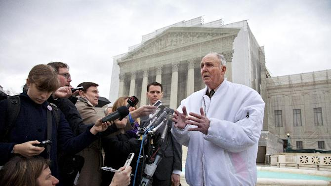 Vernon Hugh Bowman, a 75-year-old Indiana soybean farmer, speaks with reporters outside the Supreme Court in Washington, Tuesday, Feb. 19, 2013, after justices heard oral arguments between Bowman and high-tech agriculture company Monsanto Co. that produces genetically engineered and patented seeds. The case is to consider whether Bowman violated Monsanto's patents when he planted an unmarked mix of soybeans that he bought from a grain elevator and that is often used for feed. At rear is Bowman's lawyer, Mark Walters.  (AP Photo/J. Scott Applewhite)